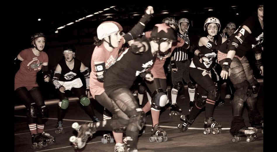 "This Saturday, the Berlin Bombshells will be opening the Roller Derby season at Arena Berlin. Above, ""blockers"" try to stop the ""jammer"" (star helmet), from making it through the pack by blocking them with their shoulders or hips."