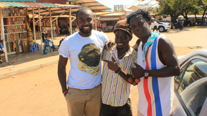 Asante visits a market in Ghana to buy souvenirs from jewelers, artists and musicians during his two-week vacation.