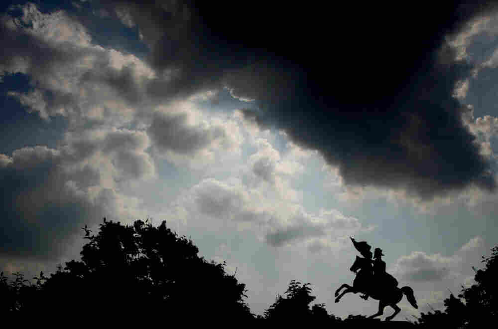 A dark cloud passes over a statue of Napoleon in Vienna.