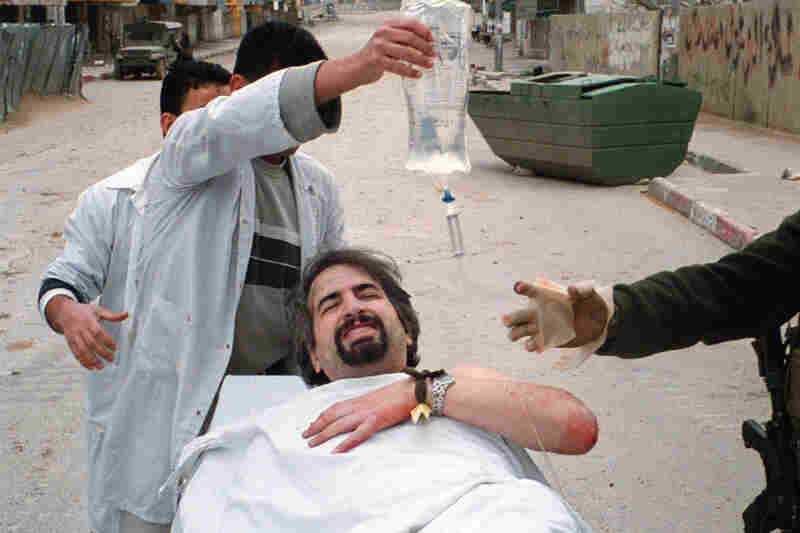 In 2002, while working for the Boston Globe, Shadid was shot in the shoulder while reporting in the West Bank city of Ramallah.