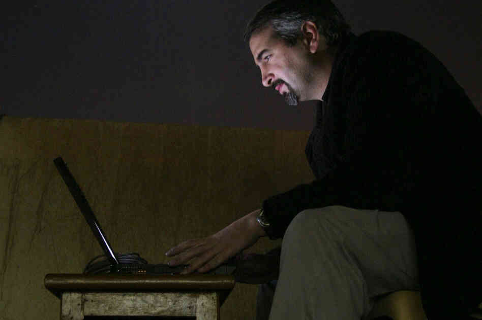 Pulitzer Prize-winning journalist Anthony Shadid died of an apparent asthma attack on Feb. 16, while on a reporting trip in Syria. Pictured here in 2003, while working for The Washington Post, Shadid types by moonlight on a hotel rooftop in Najaf, south of Baghdad, Iraq.