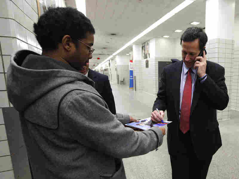 Rick Santorum stops to sign a photograph after speaking at the Economic Club of Detroit on Thursday. It marked one of Santorum's first campaign events in Michigan, which holds its Republican primary Feb. 28.