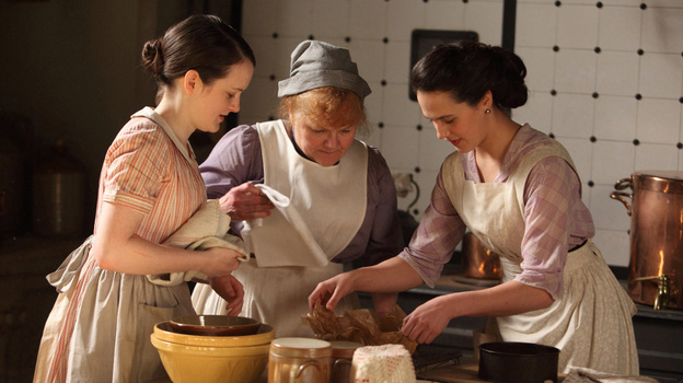 """Downton Abbey's"" kitchen maid (Sophie McShera) and cook (Lesley Nicol) teach Lady Sybil (Jessica Brown-Findlay) the basics of cooking. Many Edwardian servants had a pretty good handle on advanced cuisines, says food historian Ivan Day.  (Courtesy (C) Carnival Film & Television Limited 2011 for Masterpiece)"