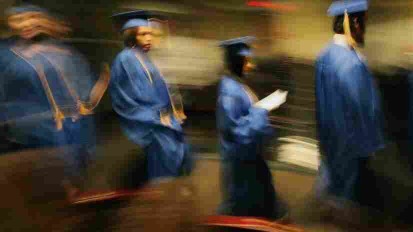 """In Cleveland, 2010 GED graduates from the Get On Track program parade down the aisle during their commencement. In today's economy, some experts say, the GED may not be enough to provide """"gainful employment."""""""