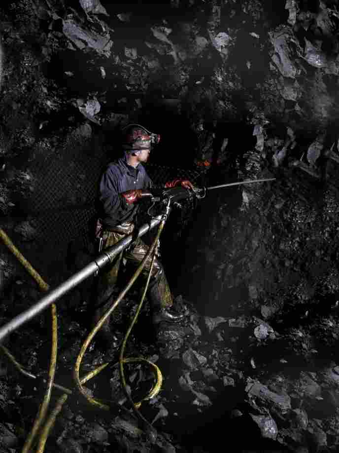 The recent spike in metal prices, combined with a shortage of miners, means mining companies are hiring. So some teens are opting not to go to college, and instead are heading underground. A miner is shown at work in Newmont Mining's Leeville mine near Carlin, Nev.