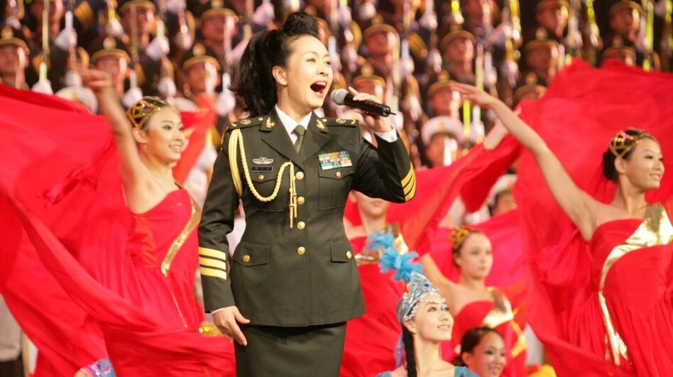 Peng Liyuan, the wife of Chinese Vice President Xi Jinping, sings during a July 2007 performance celebrating the 80th anniversary of the founding of the People's Liberation Army of China.  (Xinhua/Landov)