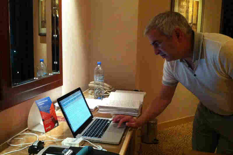 A new book by Shadid, House of Stone, will be published next month. Here, he balances reporting in Manama, Bahrain, with tweaking the manuscript (to his right).