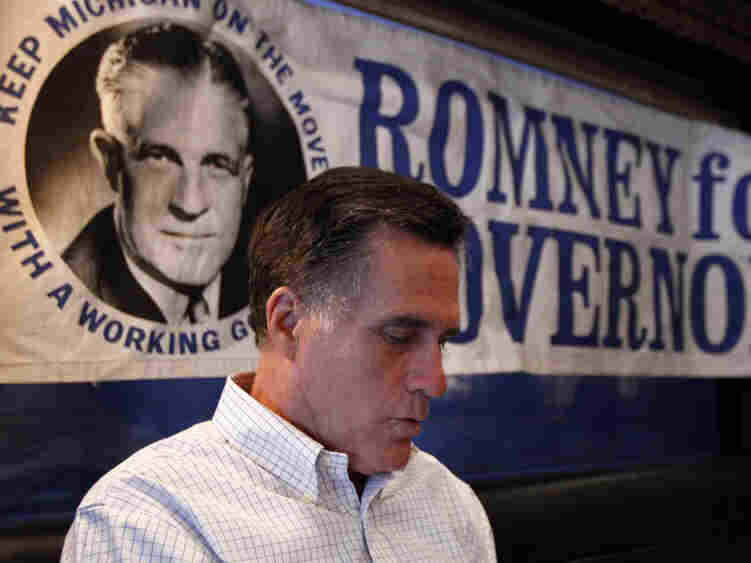 GOP presidential candidate Mitt Romney between campaign stops in Michigan. He sits next to an old campaign poster for his father George Romney, a three term governor for Michigan.
