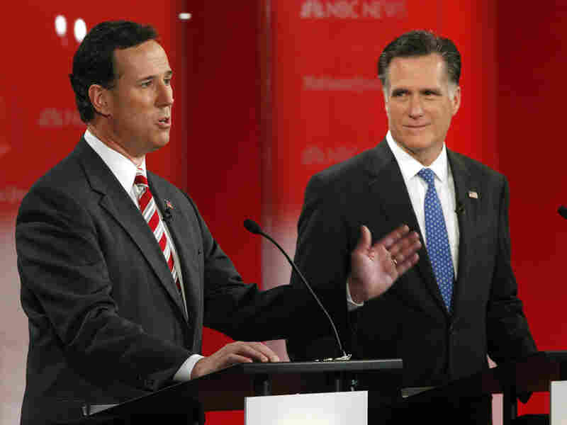 Rick Santorum and Mitt Romney took the stage in a January presidential debate in Florida. They'll meet again Wednesday night in Arizona, which holds its primary on Feb. 28, the same day as the crucial Michigan contest.