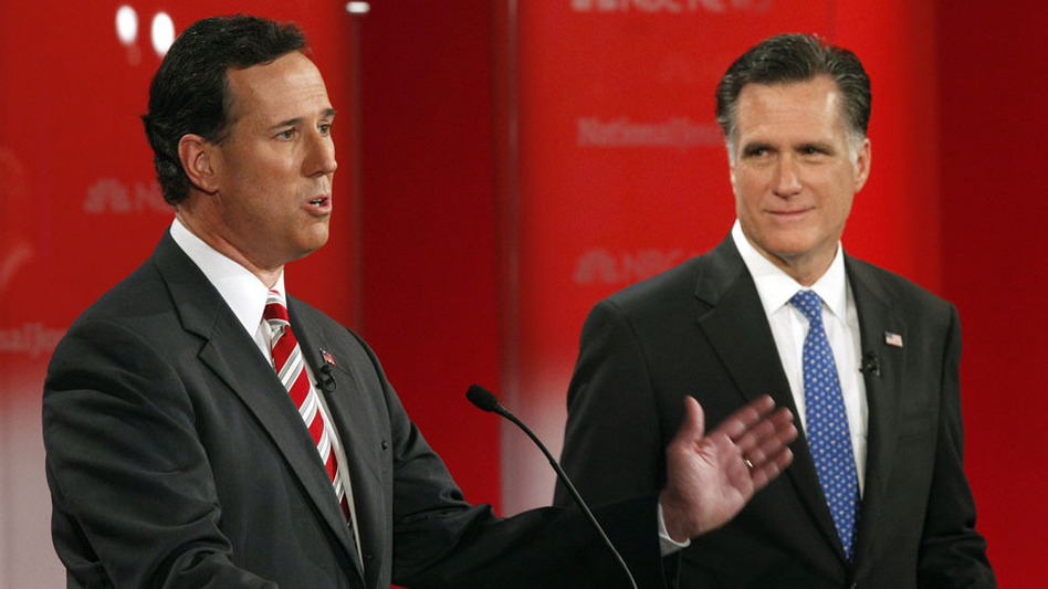 Rick Santorum and Mitt Romney took the stage in a January presidential debate in Florida. They'll meet again Wednesday night in Arizona, which holds its primary on Feb. 28, the same day as the crucial Michigan contest. (AP)