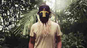 The British producer SBTRKT wears one of his many the African-inspired masks.