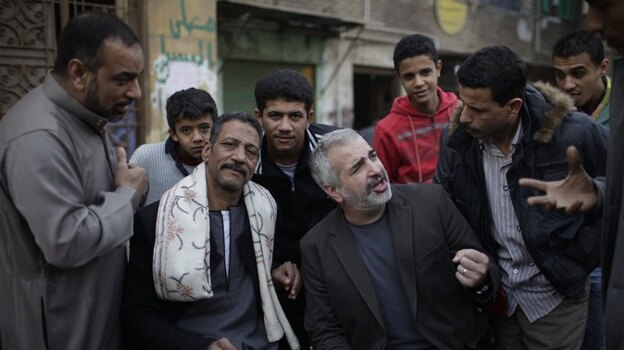 New York Times journalist Anthony Shadid (second from right) reported from Embaba, a neighborhood in Cairo, in February 2011 during the revolution that toppled Egyptian President Hosni Mubarak.  (Getty Images)