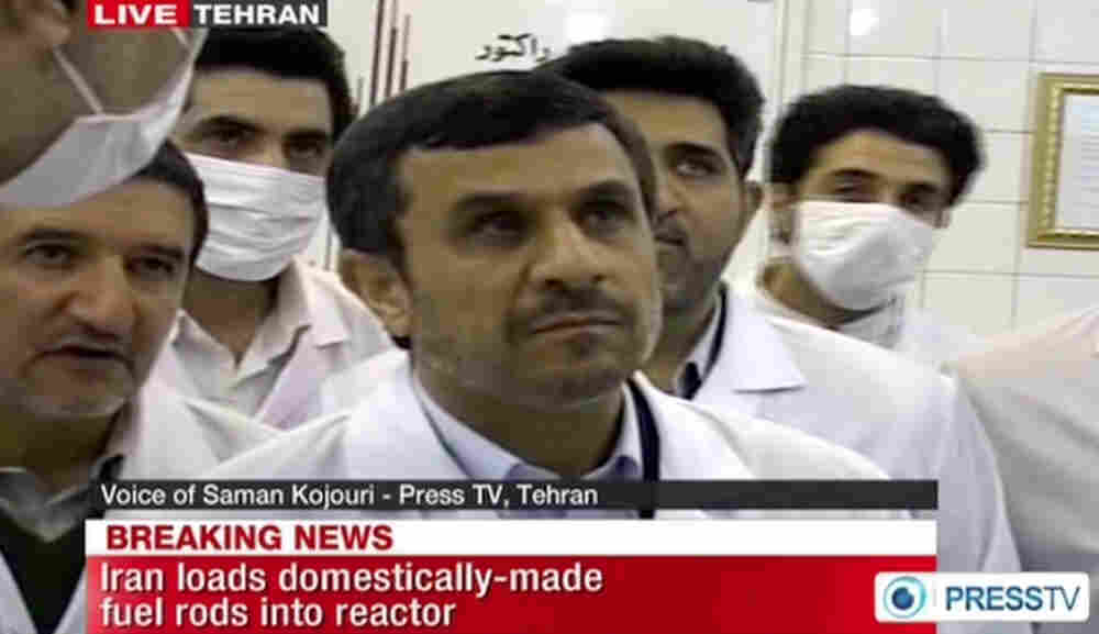 Iran's state-run Press TV showed images of Iranian President Mahmoud Ahmadinejad touring Tehran's research reactor on Wednesday.