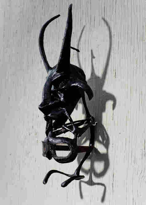 """Another mask on Maikoiyo Alley-Barnes' studio wall. """"The thing I'm talking about predates language,"""" Alley-Barnes says. """"It's primal."""""""