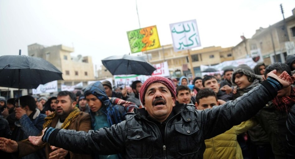 Syrians demonstrate against the regime after Friday prayers in the north Syrian city of Idlib on Friday. Thousands of Syrians rallied to demand Bashar al-Assad's ouster, as the embattled president's forces unleashed their heaviest pounding yet of Homs in a brutal bid to crush dissent, monitors said.  (Bulent Kilic /AFP/Getty Images)