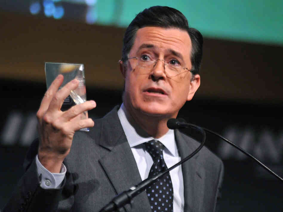 Stephen Colbert, seen here in a file photo from November 2011, postponed production