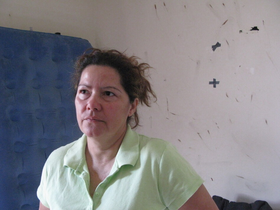 Luz Escamilla's bedroom walls are stained with the blood of bedbugs. She says she doesn't want to bleach them until reps from CW Capital, her landlord, pay an in-person visit to her Maryland home.  (Aarti Shahani/NPR)
