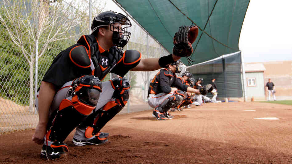 Catcher Buster Posey, seen here during a spring training workout Sunday, has been told by the San Francisco Giants that he should avoid blocking home plate. Posey broke his leg on a scoring play at the plate last season.