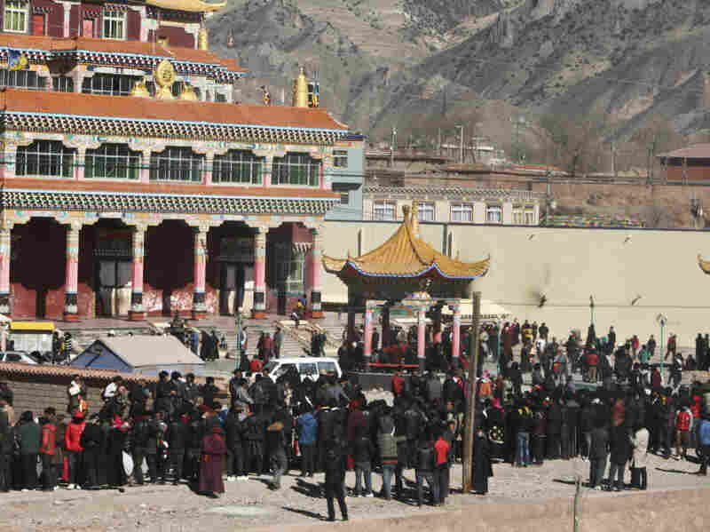 Hundreds of Tibetans gather on the side of a main street in Nangqian county, China's Qinghai province, on Feb. 8.