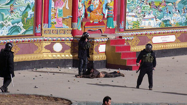 This photo, provided to freetibet.org, shows a man being forcibly detained by security forces in the town of Serther in Tibet following a clash with protesters and police.