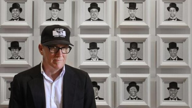 Kurt Wagner in front of some of his paintings.