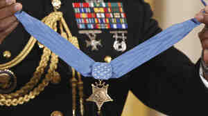 The Medal of Honor is held by a military honor guard at the White House last September, when President Obama awarded the medal to Marine Cpl. Dakota Meyer, 23, from Greensburg, Ky., for his actions in Afghanistan. The Supreme Court is now deciding if those who falsely claim to have won such military awards can be prosecuted for lying.
