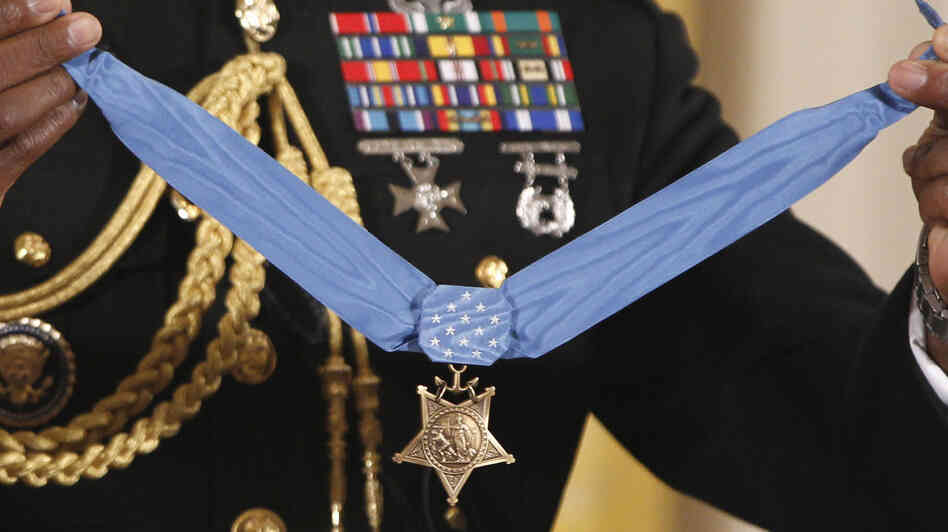 The Medal of Honor is held by a military honor guard at the White House last September, when President Obama awarded the medal to Marin