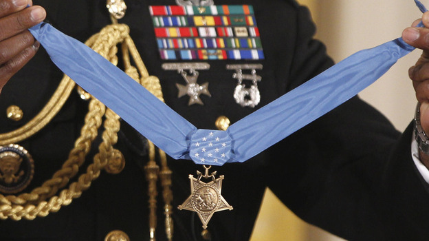 The Medal of Honor is held by a military honor guard at the White House last September, when President Obama awarded the medal to Marine Cpl. Dakota Meyer, 23, from Greensburg, Ky., for his actions in Afghanistan. The Supreme Court is now deciding if those who falsely claim to have won such military awards can be prosecuted for lying. (AP)