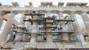 Restoration work on the pillars of the Parthenon atop Athens' Acropolis is symbolic of Europe's recent negotiations to save Greece from default.