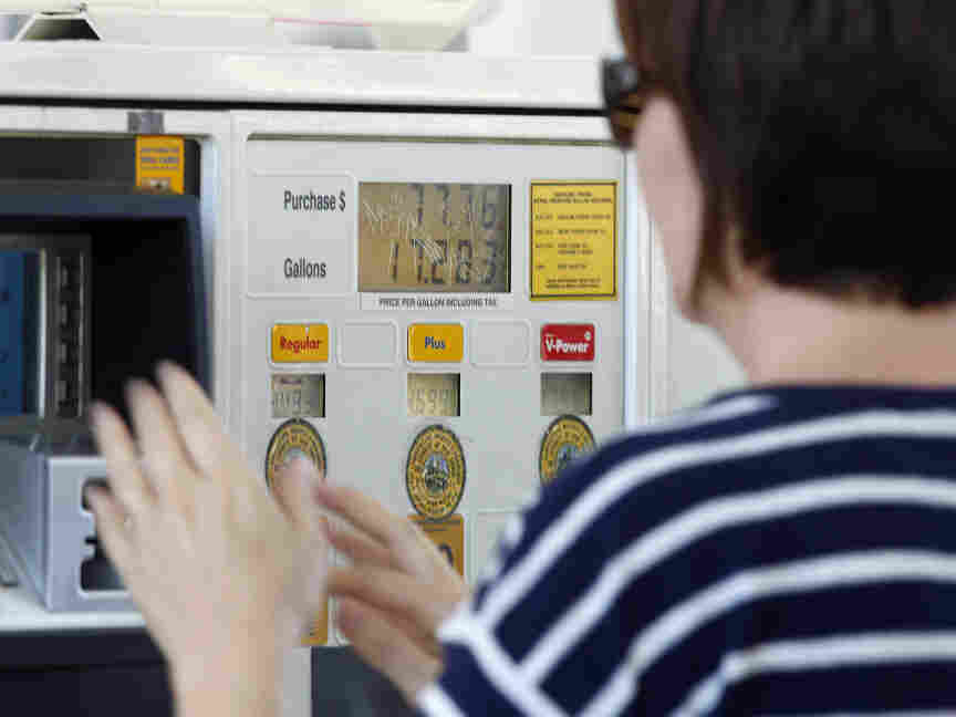A gas customer views the price on a Shell gas station pump, Tuesday, Feb. 21, 2012 in Del Mar, Calif.