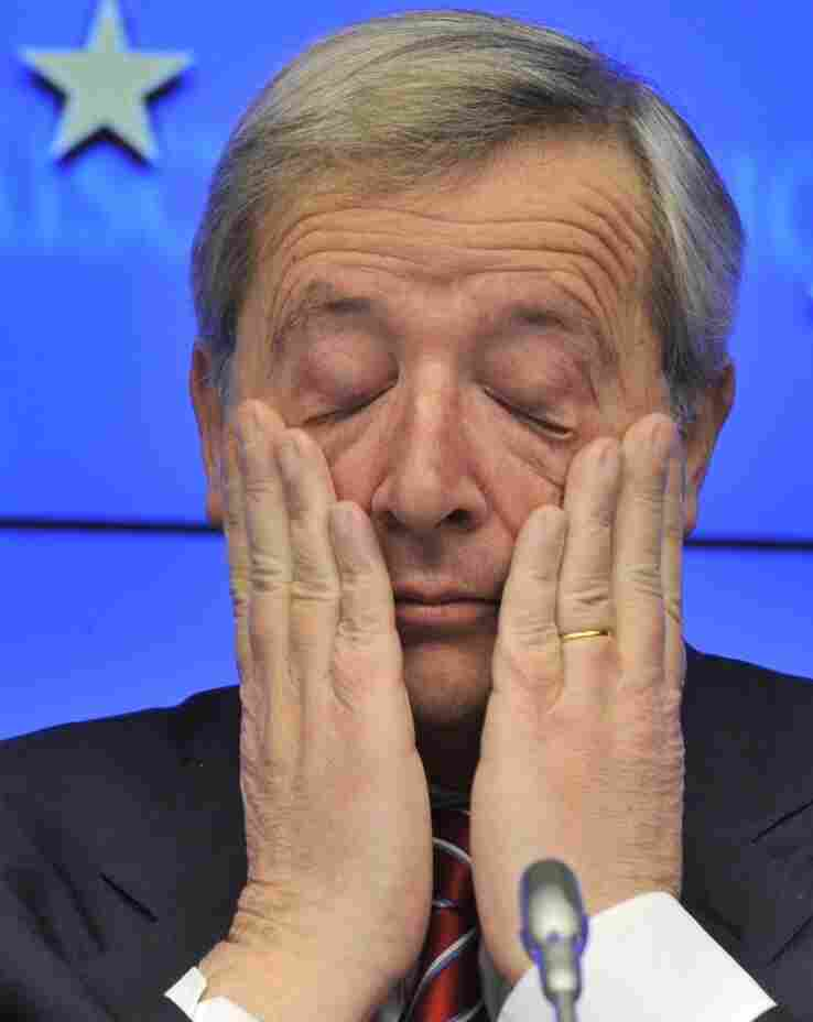 Luxembourg Prime Minister and Eurogroup President Jean-Claude Juncker scratches his eyes during a press conference following the meeting of Eurozone nations earlier today in Brussels.