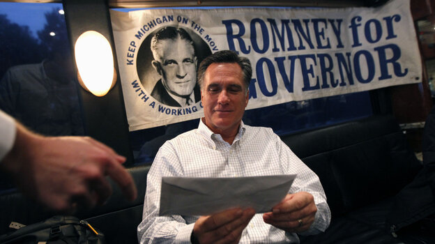 Republican presidential candidate, former Massachusetts Gov. Mitt Romney is handed mail by an aide on his campaign bus between campaign stops in Monroe, Mich., and Farmington Hills, Mich.