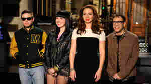 Sleigh Bells (left) stands with host Maya Rudolph and cast member Fred Armisen on the Saturday Night Live set.