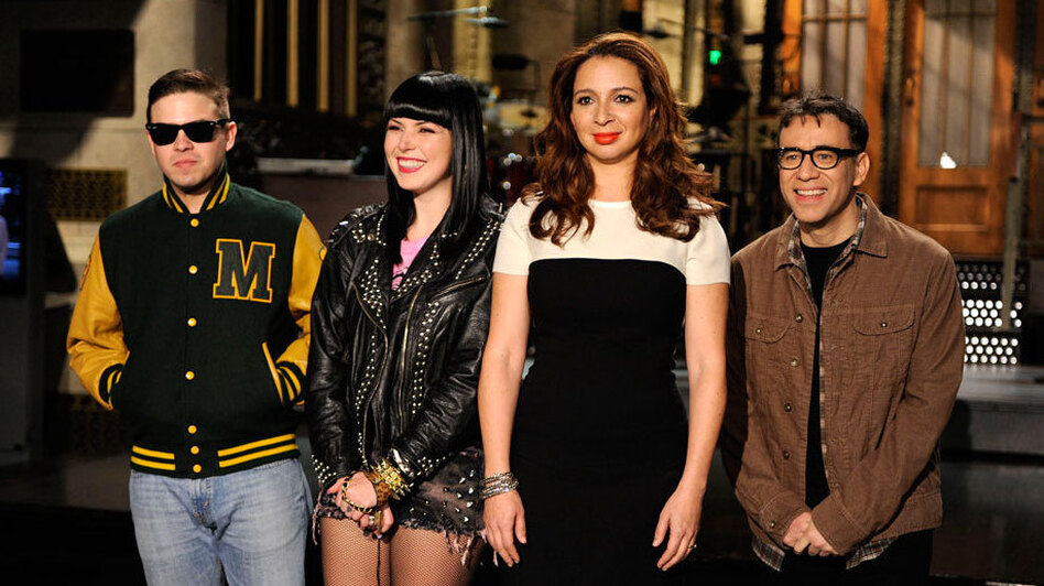 Sleigh Bells (left) stands with host Maya Rudolph and cast member Fred Armisen on the <em>Saturday Night Live</em> set.