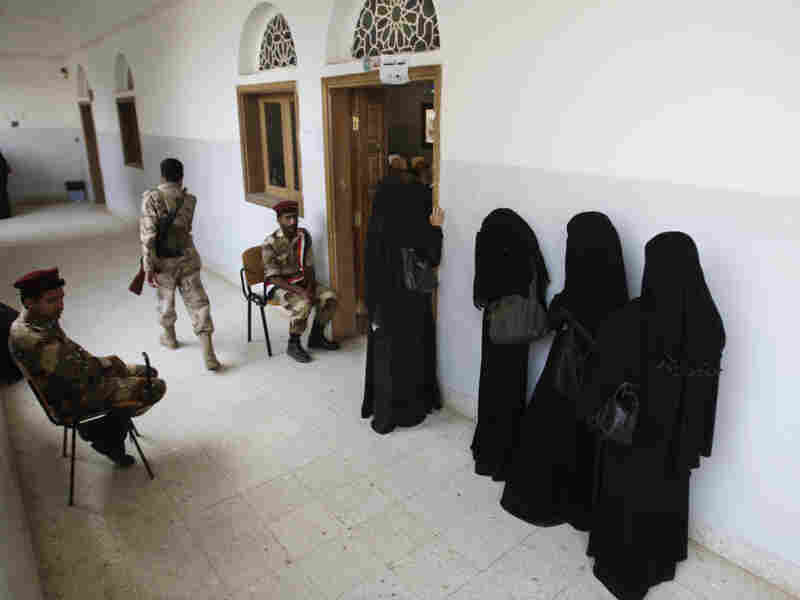 Yemeni women stand in line waiting to cast their votes at a polling station during presidential elections in Sanaa, Yemen, on Tuesday.