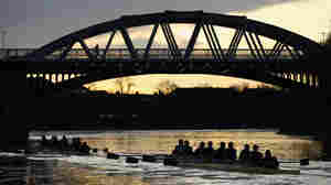 Oxford's 'Hell' and 'High Water' pass under Barnes Bridge during The Xchanging Boat Race Trial Eight's on The River Thames on December 13, 2011 in London, England.