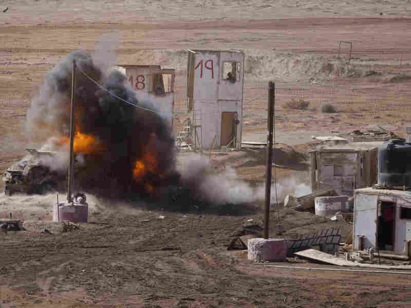 A ball of fire rises after an Israeli Merkava tank shot a shell at a truck during an army exercise on  in the Negev Desert north of the city of Eilat on Jan. 31, 2012 in Shizafon, Israel. Intervening in foreign affairs is not a new concept for Western powers.