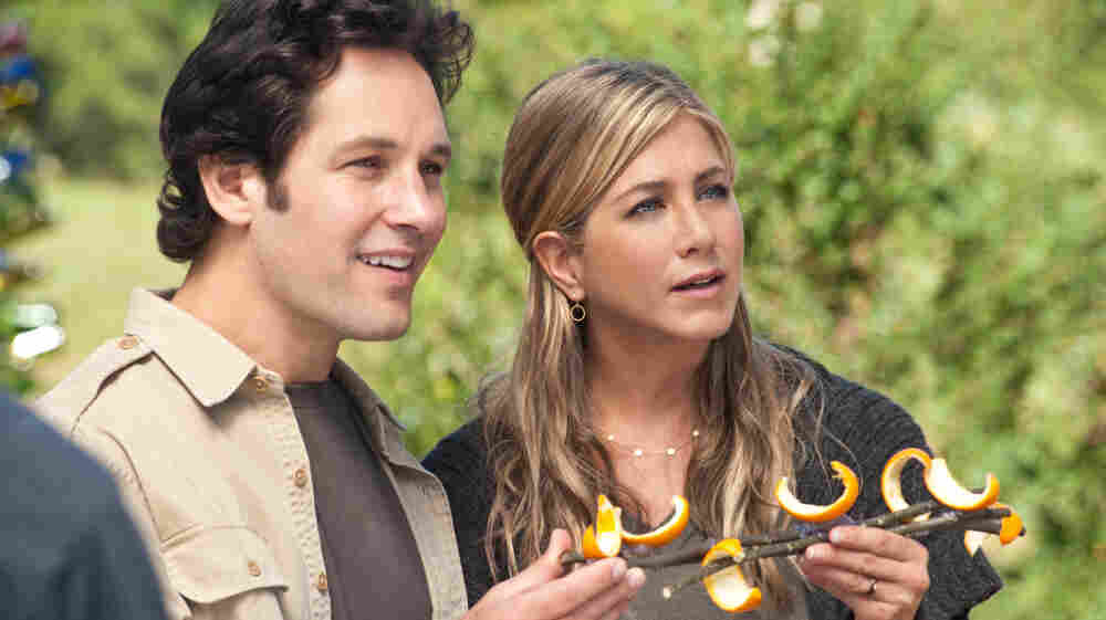 Orange You Glad We Wound Up Here? George (Paul Rudd) and Linda (Jennifer Aniston) play an unemployed Manhattan couple who stumble into a hippie farming commune whose denizens include characters played by Justin Theroux and Alan Alda.