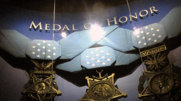 The Supreme Court heard arguments over whether it should be a crime to lie about receiving military medals. Here replicas of the medals hang at the Medal of Honor Museum.