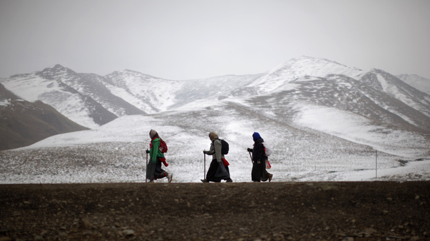 Ethnic Tibetan pilgrims walk on a road during Tibetan New Year in Langmusixiang, Sichuan province, in western China, Feb. 22. Celebrations are subdued in the Tibetan areas of China this year, after a string of self-immolations and protest against Chinese control. (Reuters /Landov)