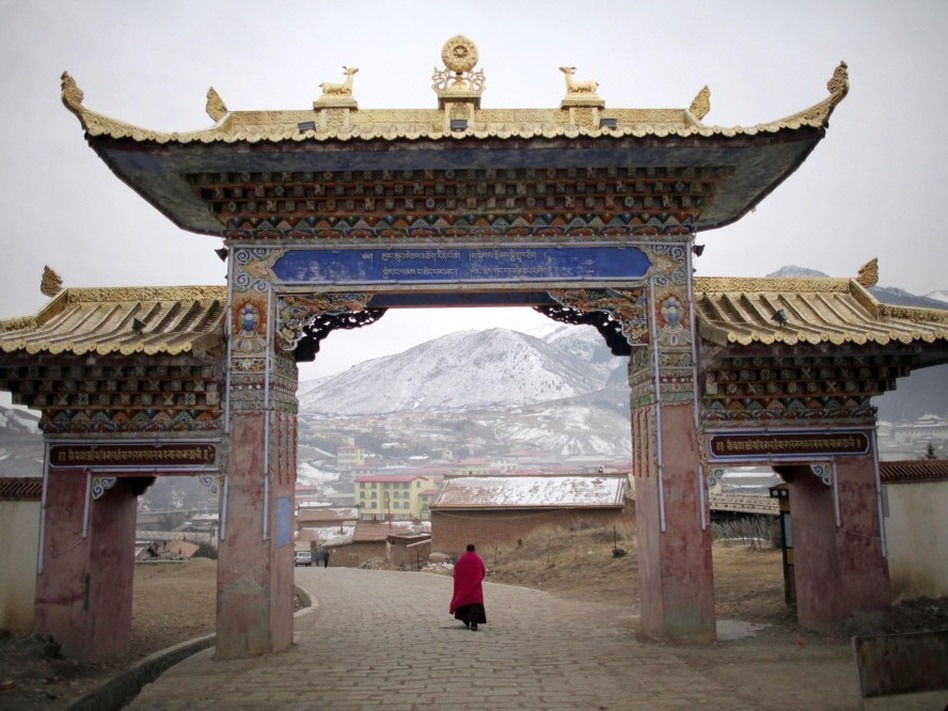 A monk walks under a temple entrance during Tibetan New Year celebrations in Langmusixiang, in China's western Sichuan Province Feb. 22, 2012.  (Reuters /Landov)