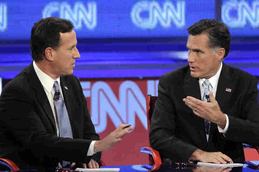 Mitt Romney debates a point with Rick Santorum during a Republican presidential debate on Wednesday.