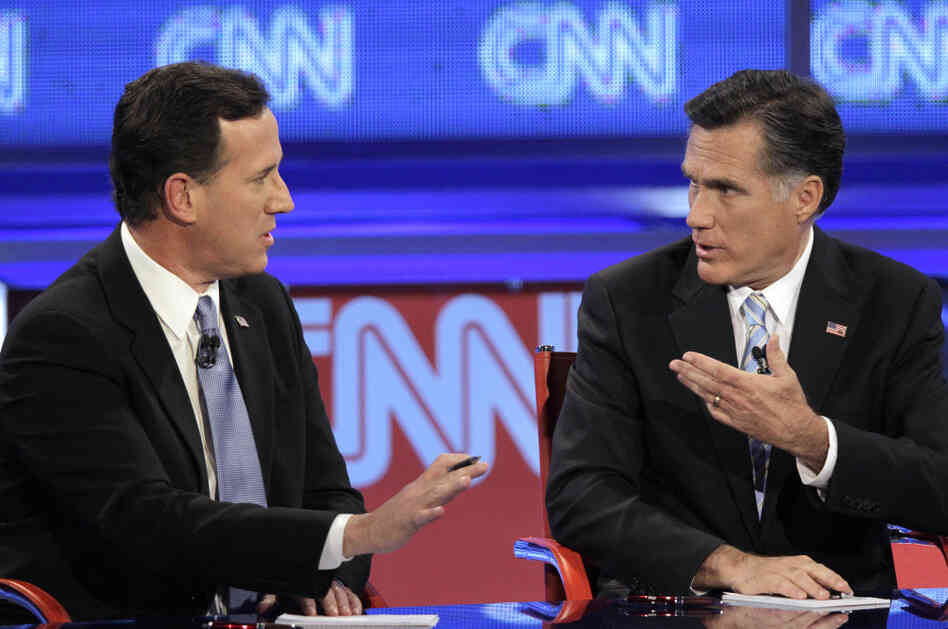 Mitt Romney debates a point with Rick Santorum during a Republican presidential debate on Wednesday.
