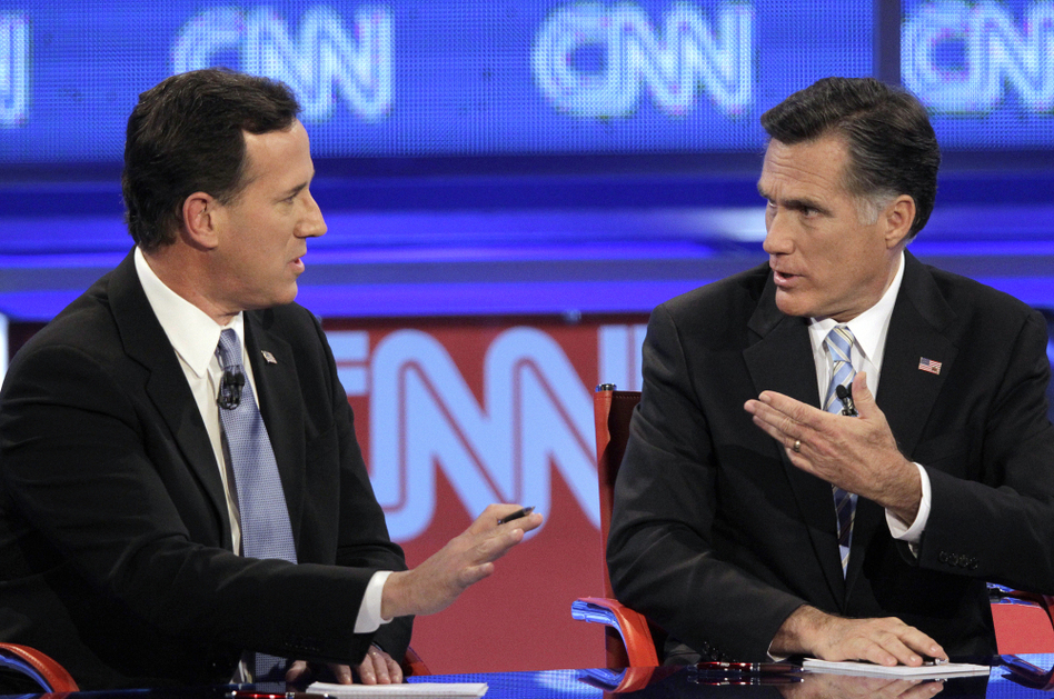 Mitt Romney debates a point with Rick Santorum during a Republican presidential debate on Wednesday. (Jae C. Hong/AP)