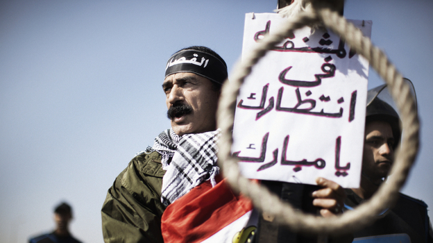 Outside the court in Cairo where former Egyptian President Hosni Mubarak has been on trial, a man earlier today held a sign saying there was a noose waiting for Mubarak.  (AFP/Getty Images)