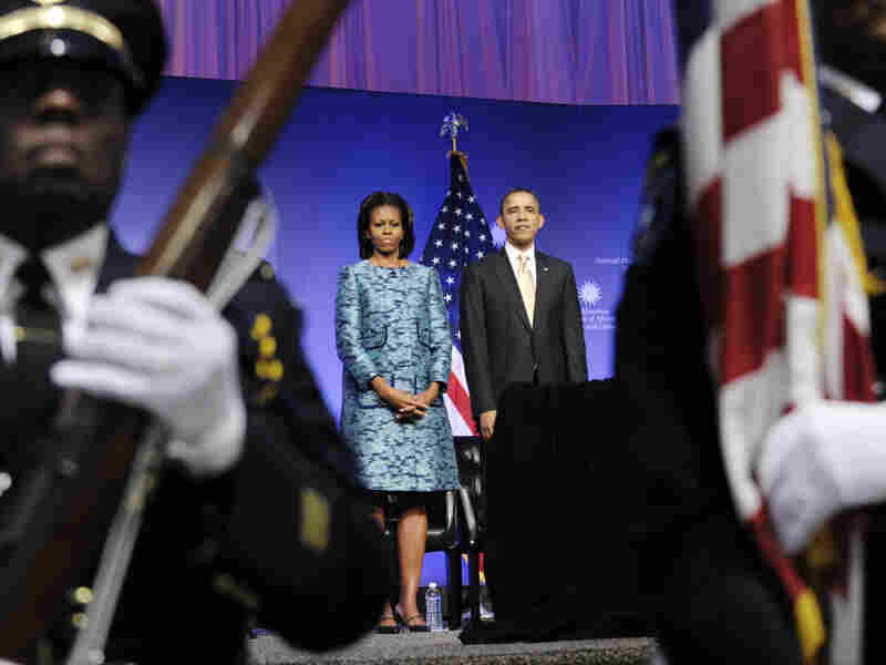 """President Barack Obama and first lady Michelle Obama attend the museum's groundbreaking ceremony. """"This day has been a long time coming,"""" Obama said."""