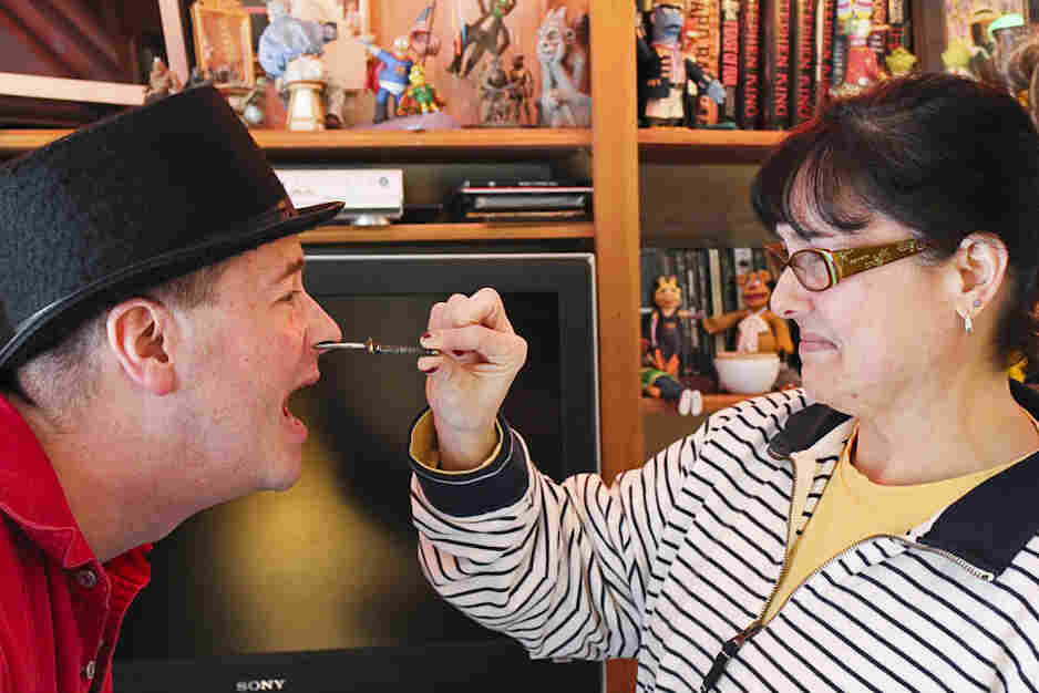Suzanne Gangi removes a 6-inch nail from her husband Tony's nose.