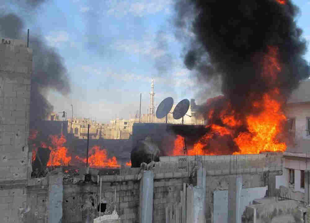 A handout picture released by Local coordination Committees in Syria (LCC Syria) on Feb. 22 shows fire on the roof of a building in the Baba Amr neighborhood of the flashpoint city of Homs.