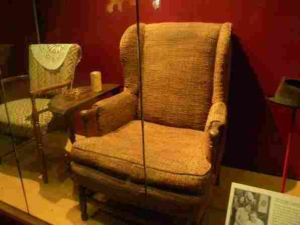 Edith and Archie Bunker's chairs on display in the Smithsonian National Museum of American History.