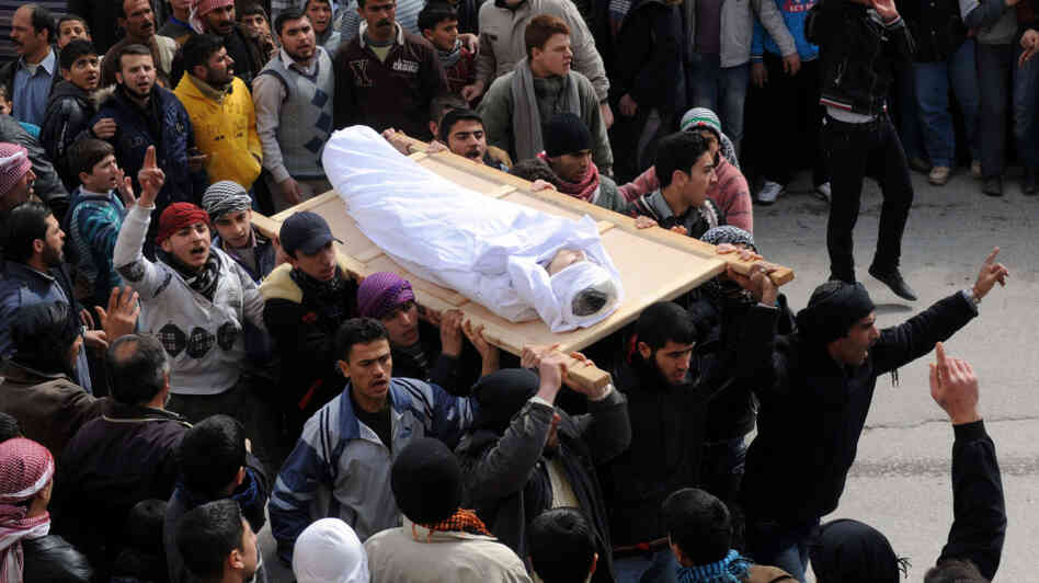 Syrians today carried the body of a youth reportedly killed in violence in the Idlib region.